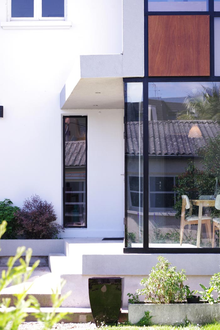Aggrandissement d'une maison de ville ave une extension réalisée par un architecte
