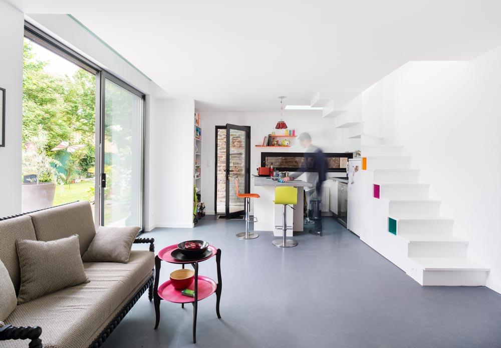 Maison avec rez-de-chaussée ouvert sur un jardin